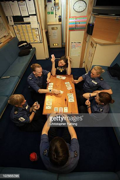 Female sailors relax by playing cards in their mess room below deck on HMS Ark Royal during Exercise Auriga on July 14 2010 at sea in Onslow Bay near...