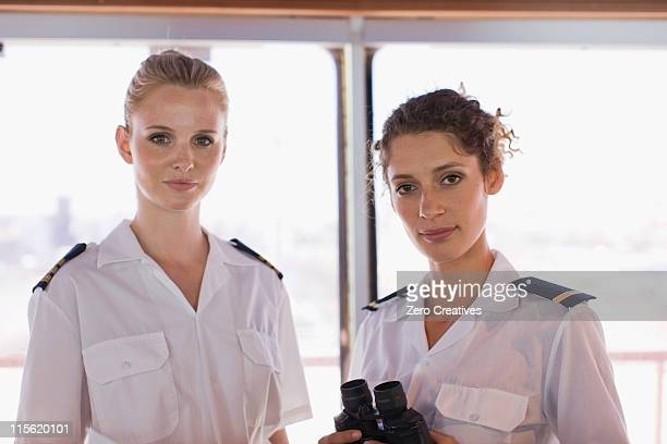 female sailors with telescope - team captain stock pictures, royalty-free photos & images