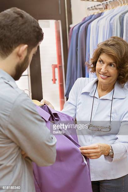 Female sale assistant in the clothing store