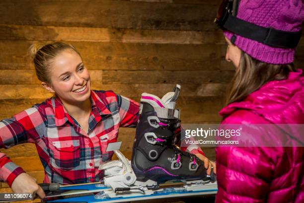 female sales assistant tuning up skis for customer. - serving sport stock pictures, royalty-free photos & images