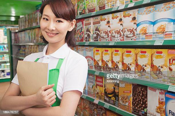 Female Sales Clerk Working in a Supermarket