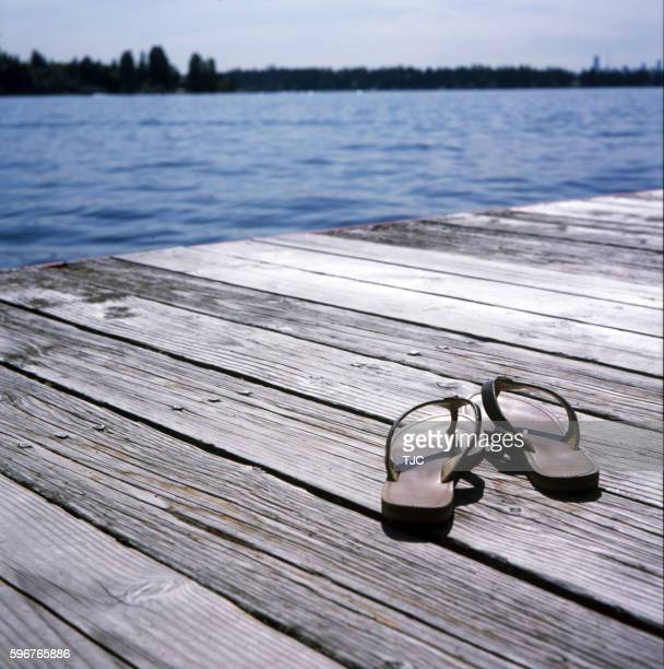 Female sandals on a dock