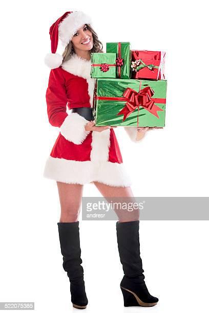 Weibliche Weihnachtsmann mit Weihnachtsgeschenke ein