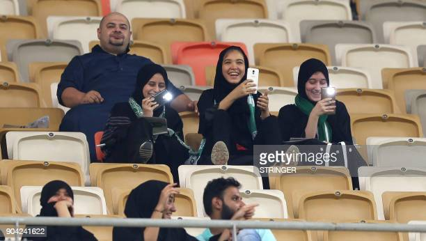 Female Saudi supporters of AlAhli attend their teams football match against AlBatin in the Saudi Pro League at the King Abdullah Sports City in...