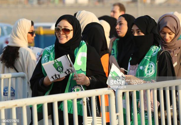 Female Saudi supporters of AlAhli queue at an entrance for families and women at the King Abdullah Sports City in Jeddah on January 12 ahead of their...