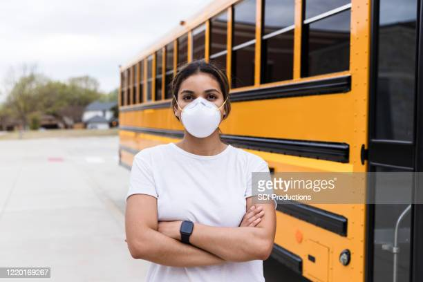 female school bus driver wearing n95 mask - school bus stock pictures, royalty-free photos & images