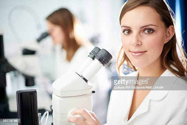 Female science student with microscope