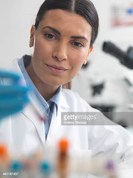 female scientist about to view a sample under a microscope - microbiologist stock pictures, royalty-free photos & images
