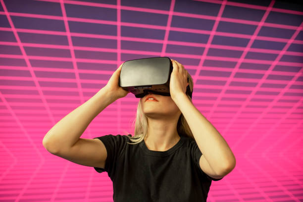 Female scientist looking through virtual reality simulator against grid pattern