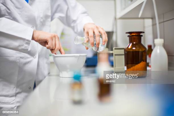 Female scientist making medicine in laboratory