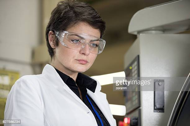 Female scientist working in production line