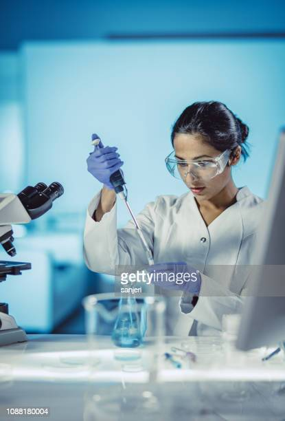 female scientist working in the laboratory - biochemistry stock pictures, royalty-free photos & images