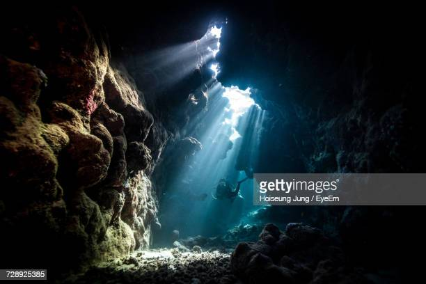 Female Scuba Diver In Underwater Cave