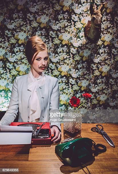 Female secretary with mustache in vintage retro se