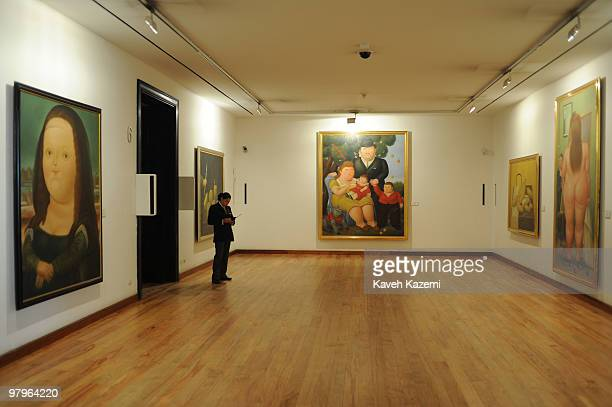 A female security guard on duty Fernando Botero museum in Bogota where a wide selection of his paintings and sculputers donated to the museum by the...