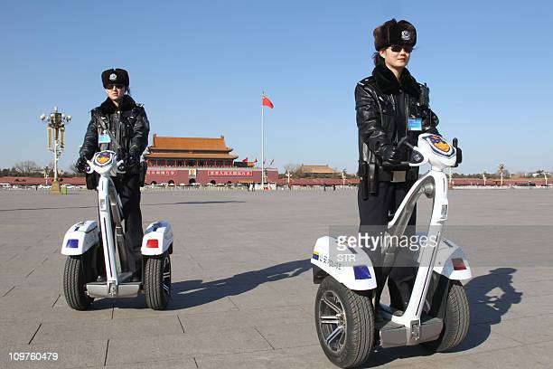 Female security personnel patrol on segwaytype vehicles around Tiananmen the location for the ongoing National People's Congress in Beijing on March...