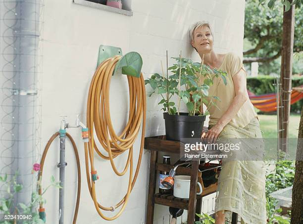 female senior in garden - older women in short skirts stock pictures, royalty-free photos & images