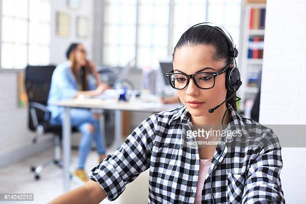 Female service agent working at workplace