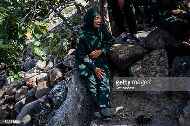 A female sharia police known as Wilayatul Hisbah take a rest in beach as they patrol on December 12 2014 in Banda Aceh Indonesia Aceh is the only...