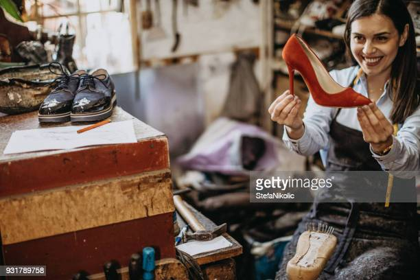 female shoemaker loves red shoes - red shoe stock pictures, royalty-free photos & images