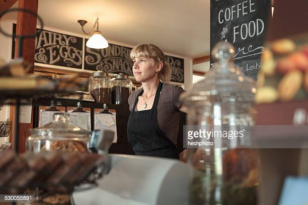 female shop assistant in country store cafe - heshphoto stock pictures, royalty-free photos & images