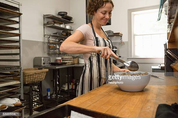 female shop assistant preparing food in kitchen at country store - heshphoto stock pictures, royalty-free photos & images