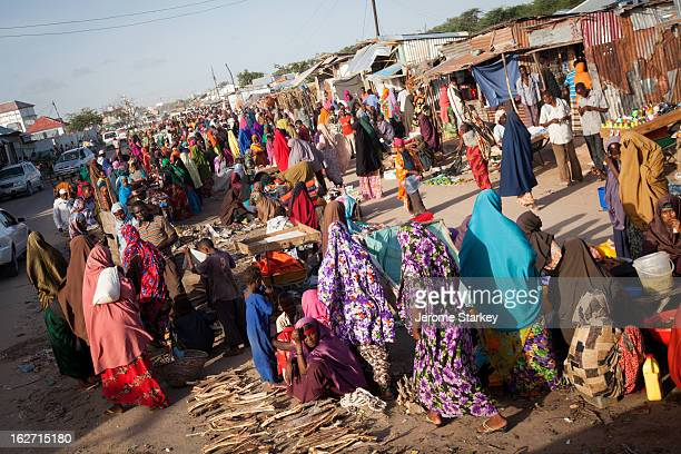 Female shoppers in brightly coloured shawls at an open-air market, in the out skirts of Mogadishu, Somalia, May 30, 2012. Women's rights groups...