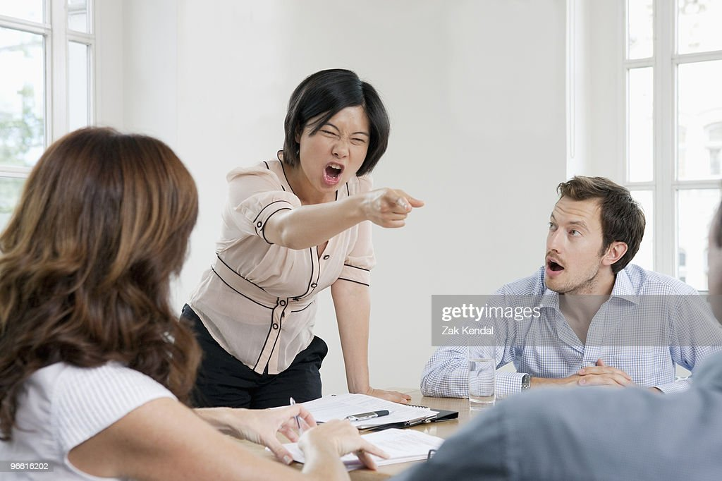 Female shouting in a meeting : Stock Photo