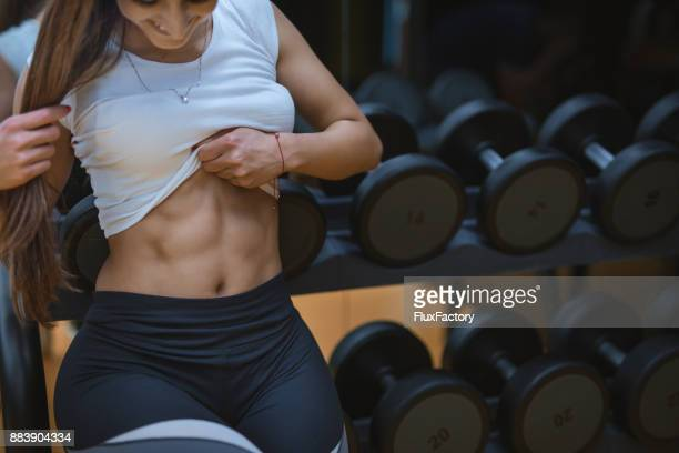 female showing off her abs - yoga pants stock photos and pictures