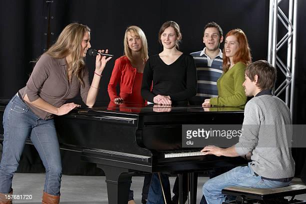 Female singer, Chorus, pianist and grand piano
