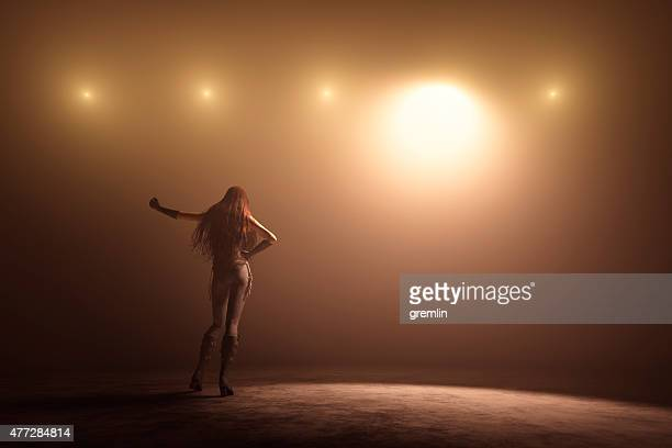 female singer on the stage - stage light stock pictures, royalty-free photos & images