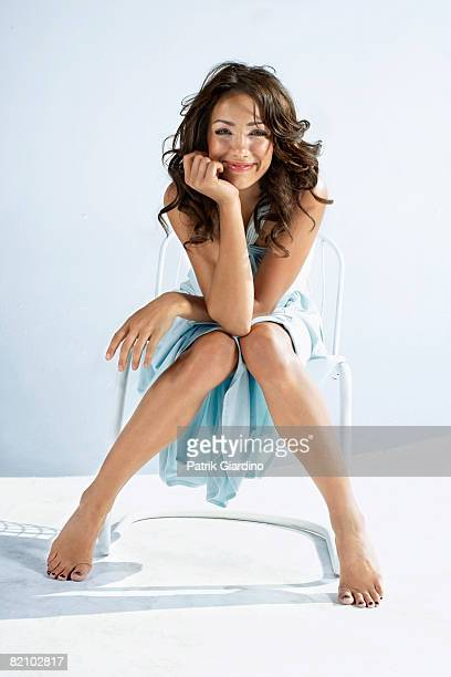 Female sitting in chair