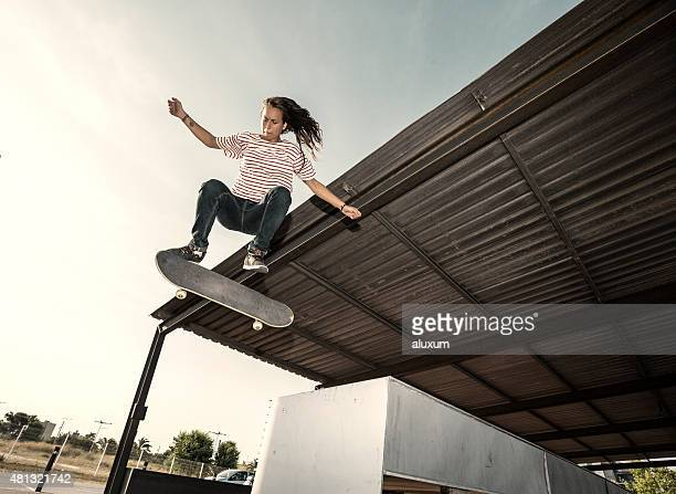Female skateboarder jumping