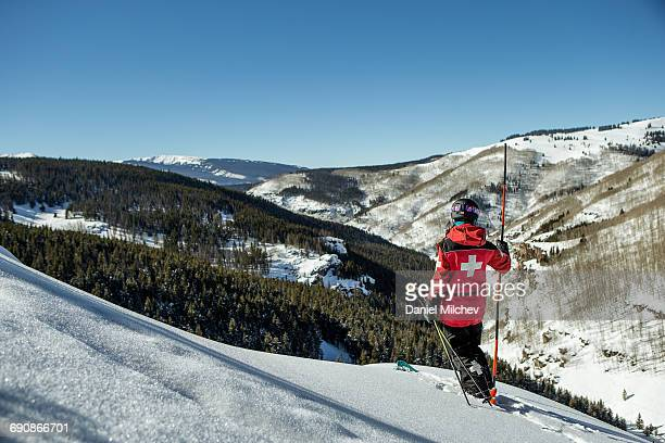 female ski patrol on skis checking the mountain. - rescue worker stock pictures, royalty-free photos & images