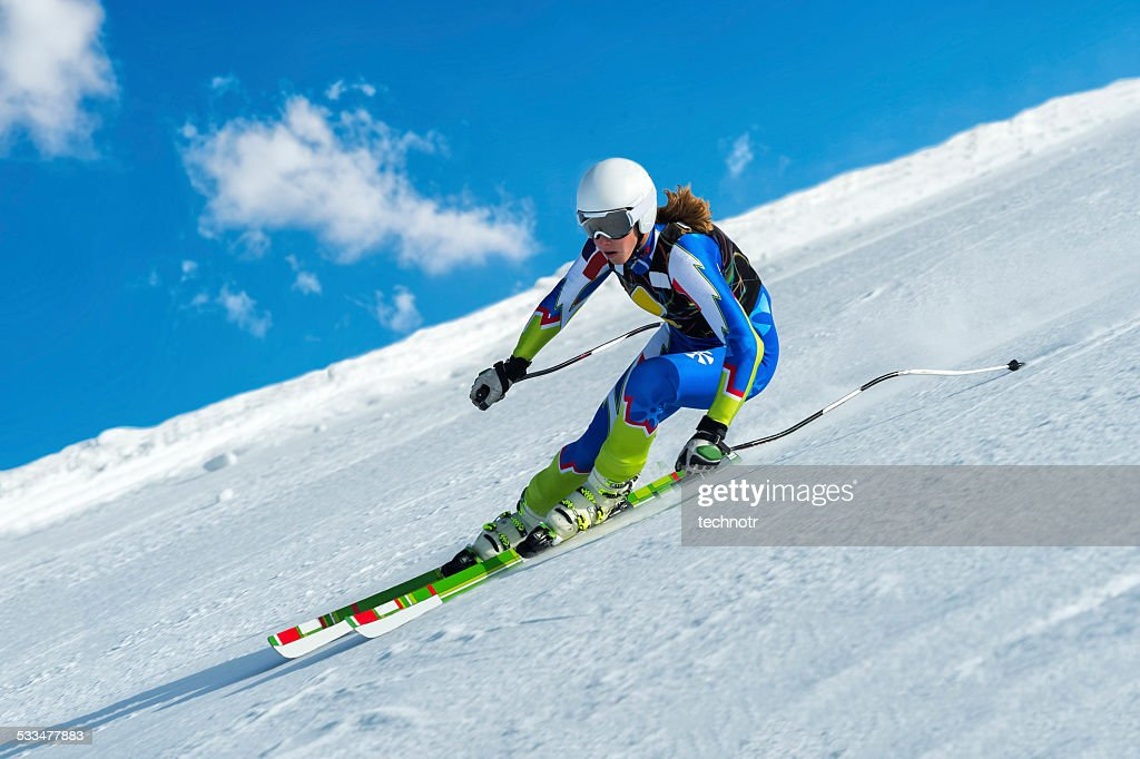 Female Skier at Straight Downhill Ski Race : Stock Photo