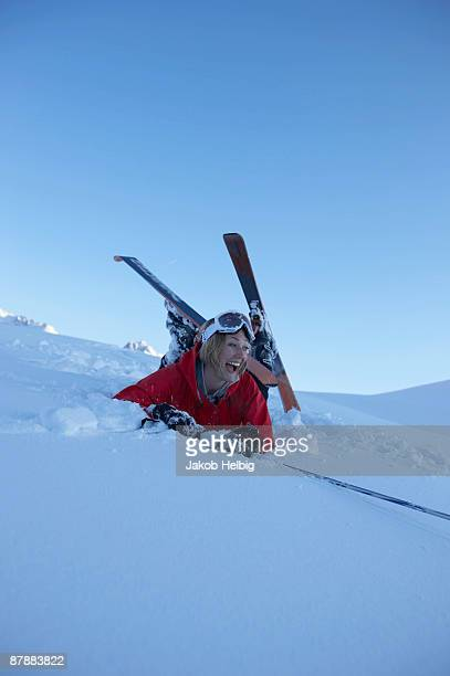 Female skier fallen over