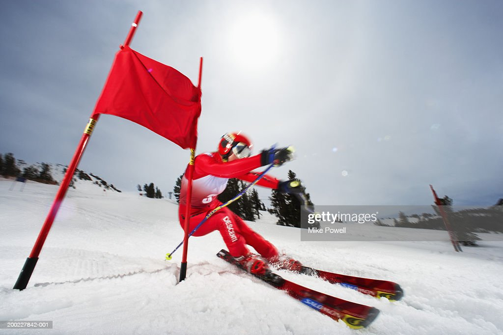 Female skier in giant slalom ski race (blurred motion) : Stock Photo