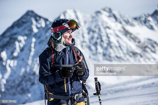 Female skier looking back to the mountains
