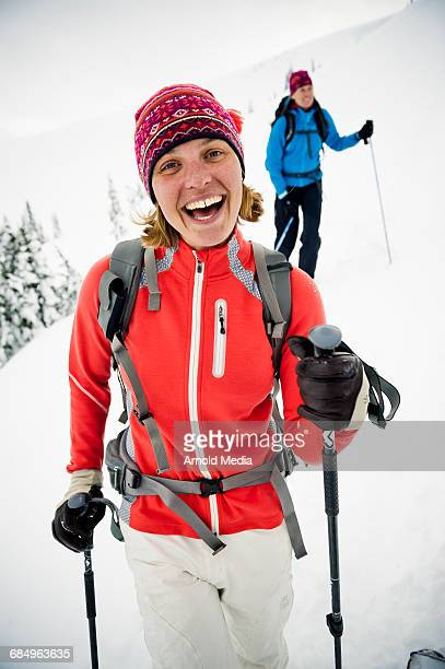 Female Skier Smiling into Camera in Mountains
