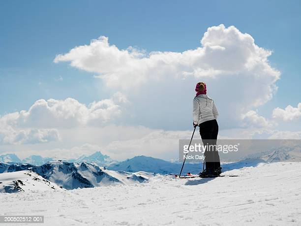 female skier standing on ski slope - meribel stock photos and pictures
