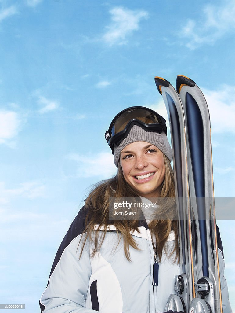 Female Skier Standing with Skis : Stock Photo