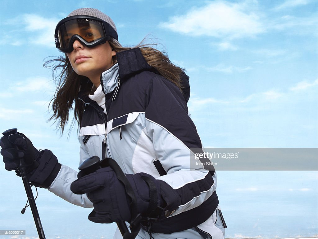 Female Skier Wearing Warm Winter Clothing : Stock Photo