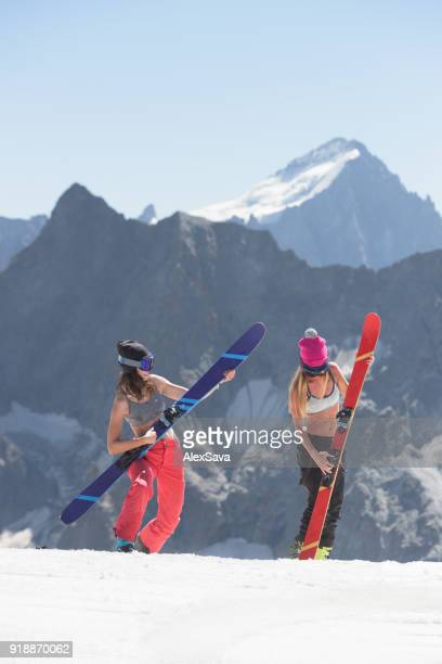 Female skiers having fun on a sunny day in mountains