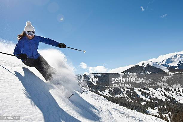 female skiing in powder snow - female skier stock pictures, royalty-free photos & images