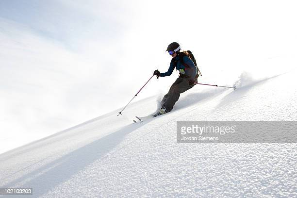 female skiing on a fresh powder day.  - bozeman stock pictures, royalty-free photos & images