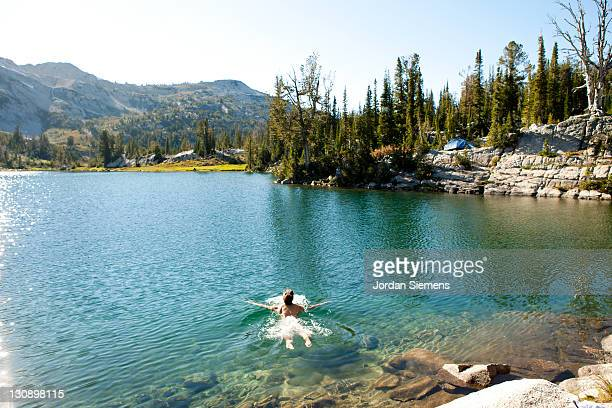 female skinny dipping in a mountian lake. - skinny dipping stock photos and pictures