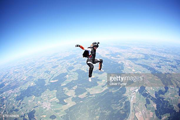 Female skydiver free falling above Leutkirch, Bavaria, Germany