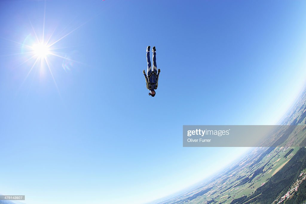 Female skydiver free falling head first above Leutkirch, Bavaria, Germany : Stock Photo
