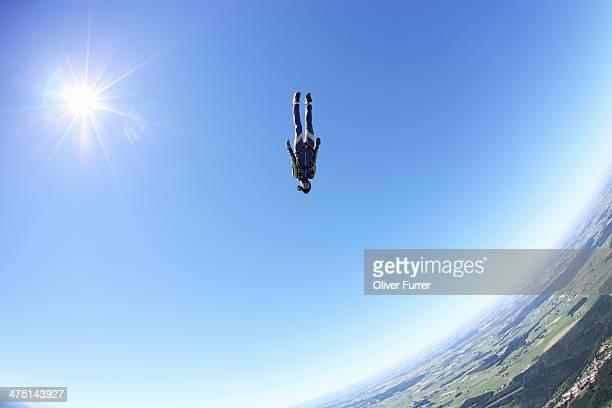 female skydiver free falling head first above leutkirch, bavaria, germany - スカイダイビング ストックフォトと画像