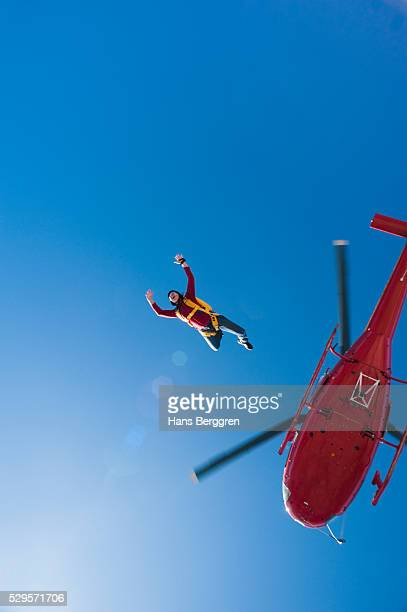 Female skydiver jumping from helicopter